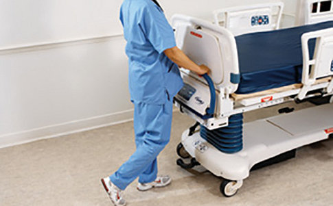 Caregiver using Epic II's Zoom Drive System