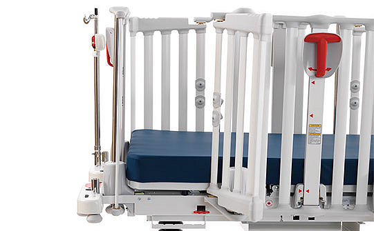 Close-up of the large-slatted siderails on Stryker's Cub Pediatric Crib