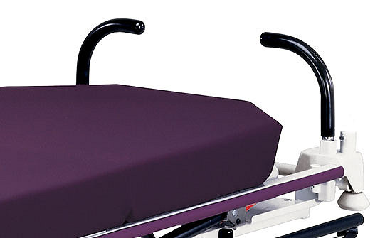 Close-up of the pop-up push handles on Stryker's Gynnie Stretcher