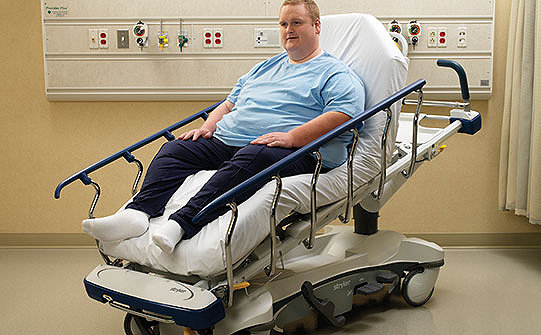 Patient on Stryker's Prime stretcher in the recovery chair position