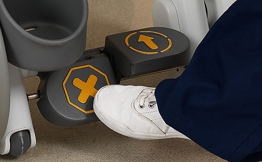 Close-up of the one-touch central brake on Stryker's Prime TC Transport Chair