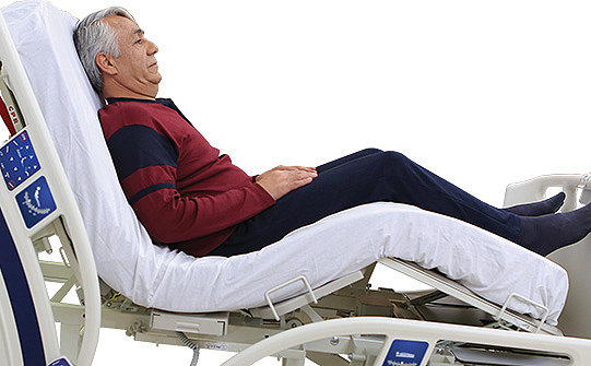 Man lying in Stryker's SV2 hospital bed with backrest in seated position