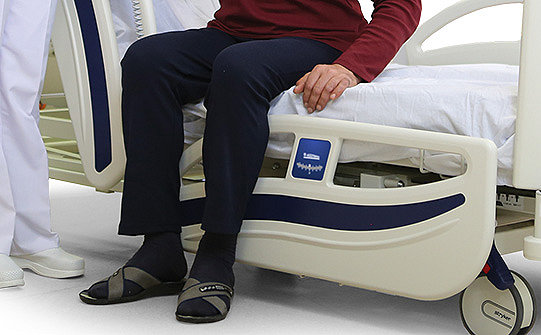 Close-up of the fold-down side rails on Stryker's SV2 hospital bed