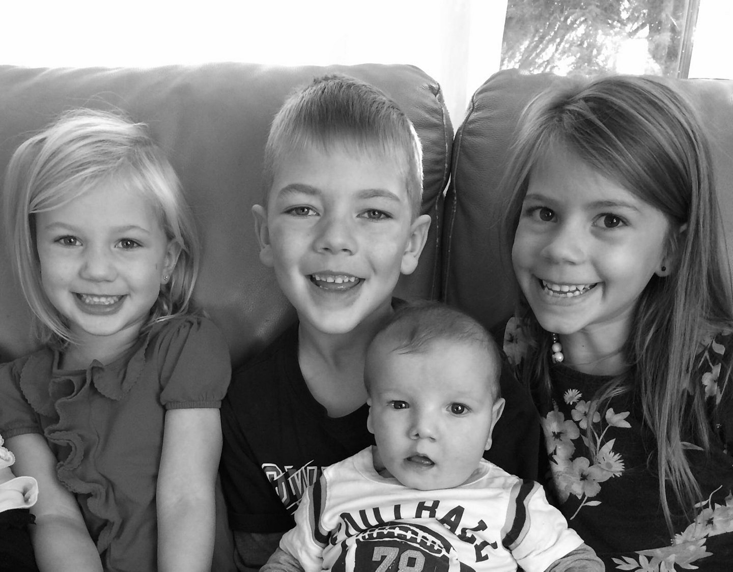 Philip post-surgery with his brother and sisters